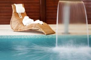 swimming pool falling water and sunbad